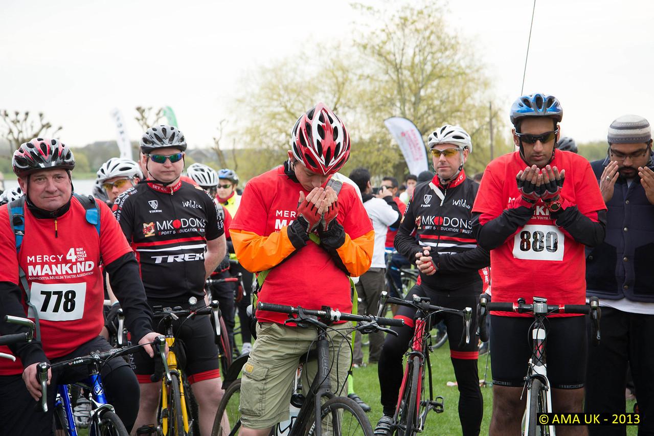 Silent prayer before start of bike event