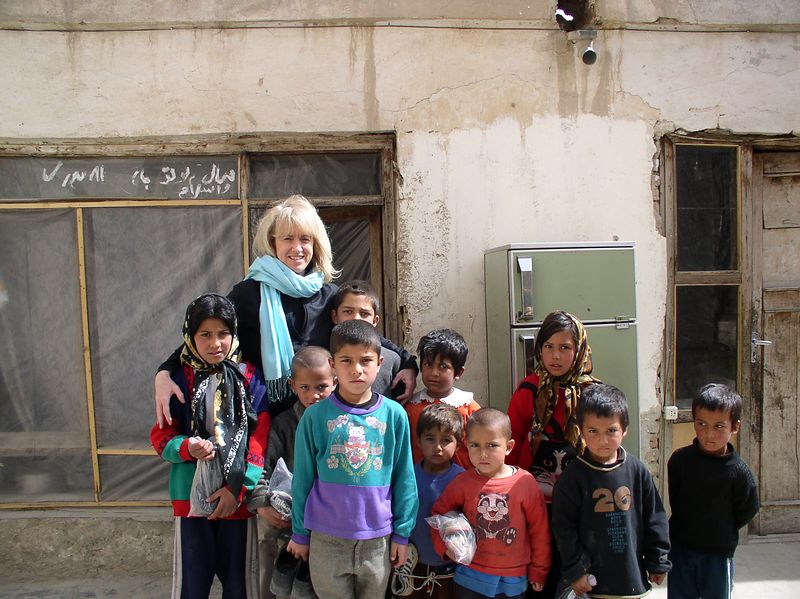 """Me and the kids - best days of my life are being here with the children. This is taken at Pashtoon's house. we are standing in front of the """"kitchen"""" room. The children are from one of her neighbor families - all related. You must see the next picture."""