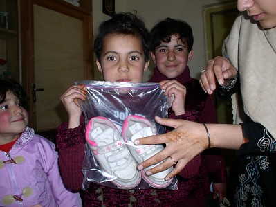 This is girl received a pair of hot pink sandals. She was very happy. She and her 3 siblings live with a widowed mother.