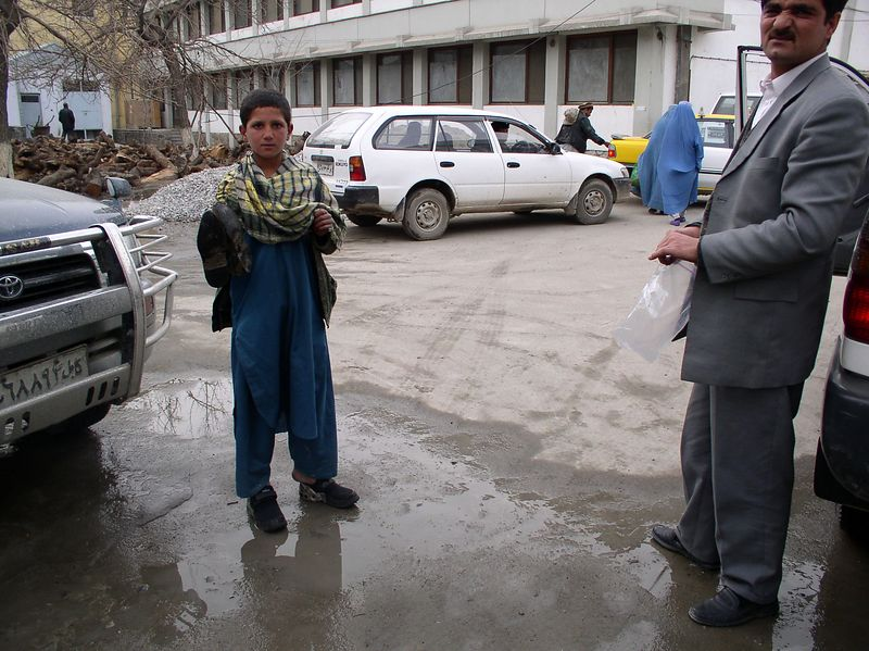 This young fellow took a new pair of shoes to replace his rubber clogs . (He had no socks). He is from a village outside of Kabul and was helping bring a sick grandmother to the hospital.