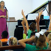 Pianist Kayla Dowling is greeted by enthusiastic participants during her interactive performance.