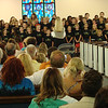 Mobile Opera's Stacey Driskell directs the Kaleidoscope Mass Choir.