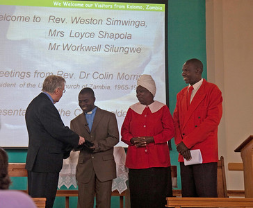 Rev Weston Simwinga receiving a special stole from Rev Dr Colin Morris
