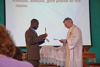 Rev Weston Simwinga accepting the Kalomo Candleholder from Rev Dr David Chapman