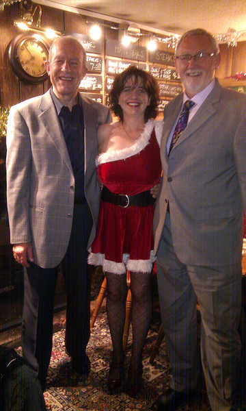 This was taken the night before at the White Hart (our local) during the official Christmas dinner.   Note the participation of Emma in the guise of 'Mother Christmas' who graciously came to help out.