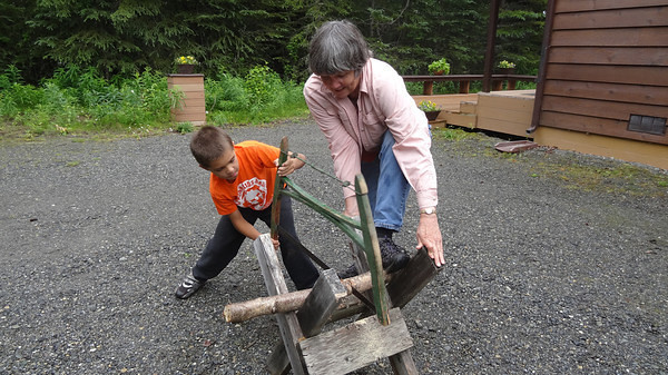 2010 teaching Connor to use his great-great-grandfather's 100 year old bucksaw.