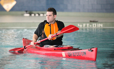 24FEB13__ Peter Malik of Elyria glides through the water at Splash Zone in Oberlin in a kayak. photo by Ray Riedel
