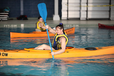 24FEB13__ Celesta Menges of Elyria practices a kayak maneuver as instructor Becky Bode watches from across the pool at Splash Zone in Oberlin on Sunday. photo by Ray Riedel
