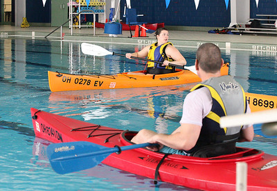 24FEB13__ Becky Bode, Wellington Reservation Natural Resource land steward, teaches kayaking techniques at Splash Zone as John Patrick looks on. photo by Ray Riedel