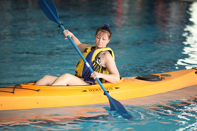 24FEB13__ Celesta Menges of Elyria concentrates on her technique during the kayaking class at Splash Zone in Oberlin on Sunday. photo by Ray Riedel
