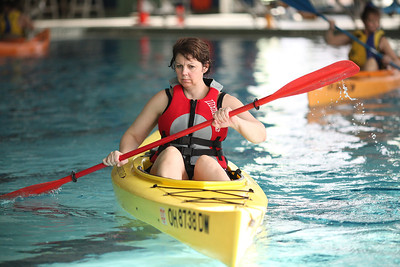 24FEB13__ Doris Patrick  of Carlisle Township concentrates on her technique during the kayaking class at Splash Zone in Oberlin on Sunday. photo by Ray Riedel