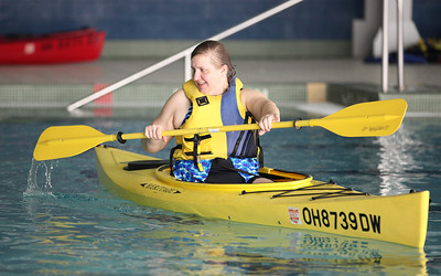 24FEB13__ Sheila Andre de la Porte enjoys the kayaking class at Splash Zone in Oberlin on Sunday. photo by Ray Riedel