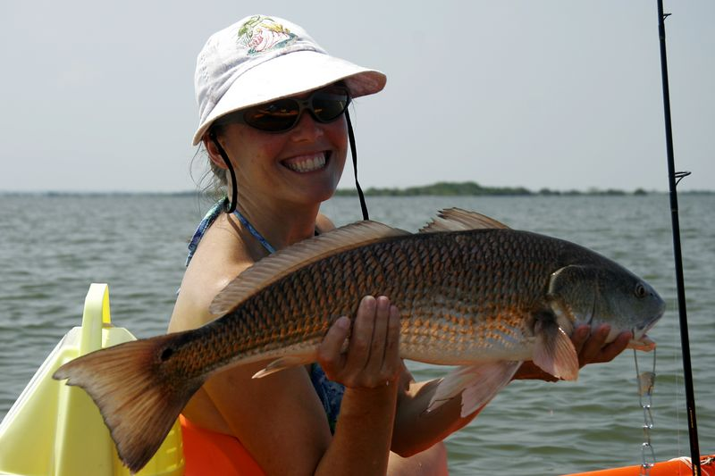 Cindy shows off her trophy redfish.