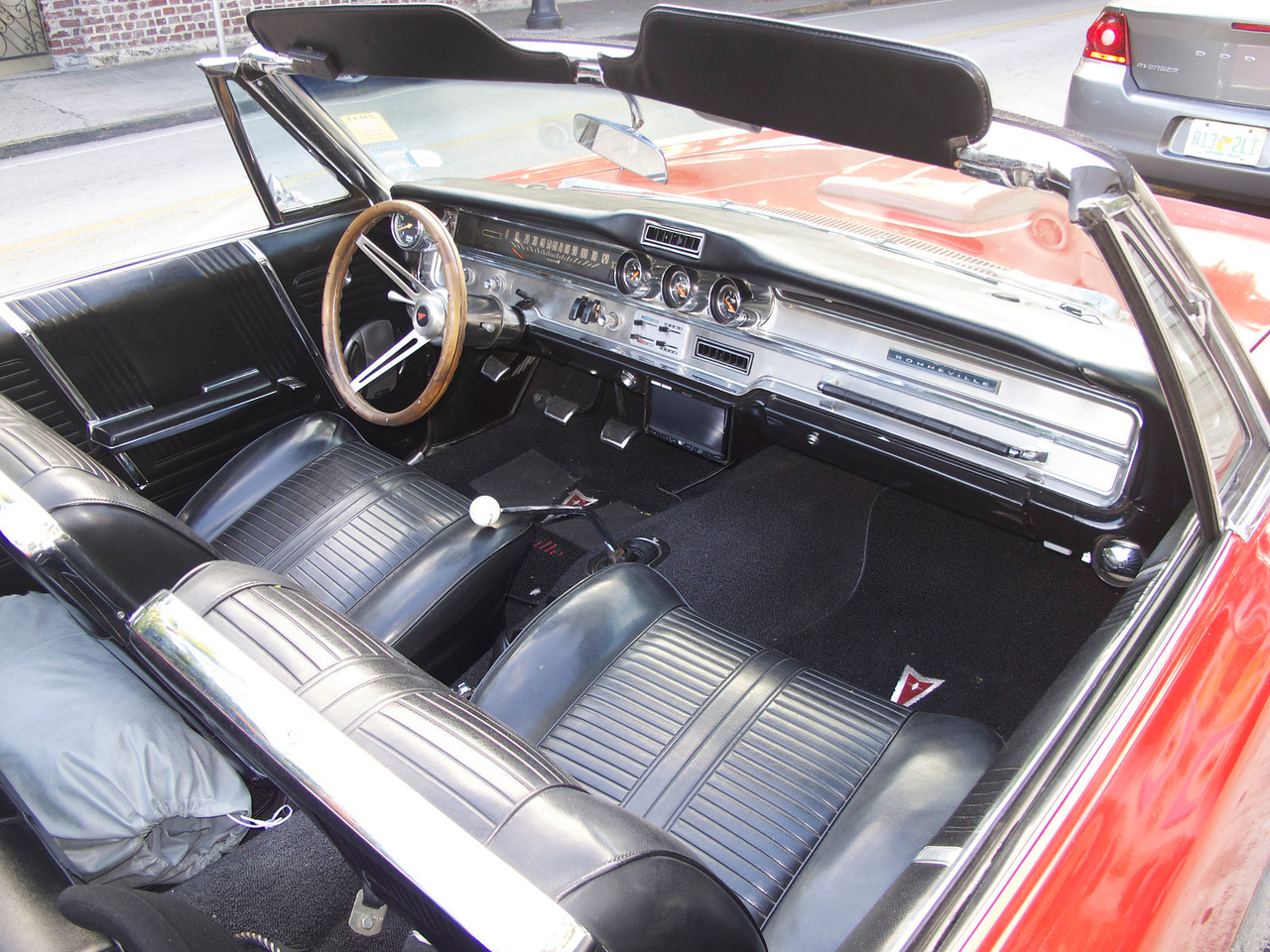 The interior of the Bonneville 421. View in the original size and scroll around. You'll see a microphone where the steering column hits the dash, you can read the instrumentation, see the foot switch for the light dimmers; there's a little disk on the passenger side of the dash with a wire coming out -- that's the antenna for the GPS you see mounted under the dash in front of the Hurst shifter.