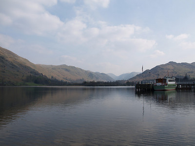 Looking south across Ullswater lake, one of the larger lakes in the Lake District south of Penrith in the North of England.  The boat to the right is one of the Ullswater steamers, a group of three boats which regularly carry people up and down the picturesque lake.