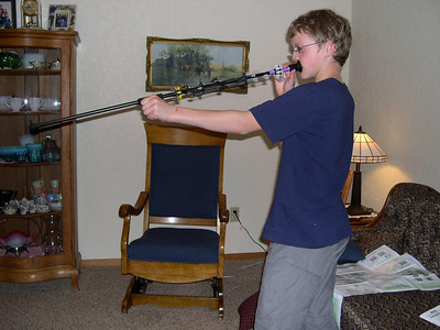 Blowgun: Mom lets him shoot it in the house. Yikes!