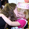 Anna Cattles gets a hug and kiss from her mom, Rachel.<br /> <br /> Photo by Chris Rourke