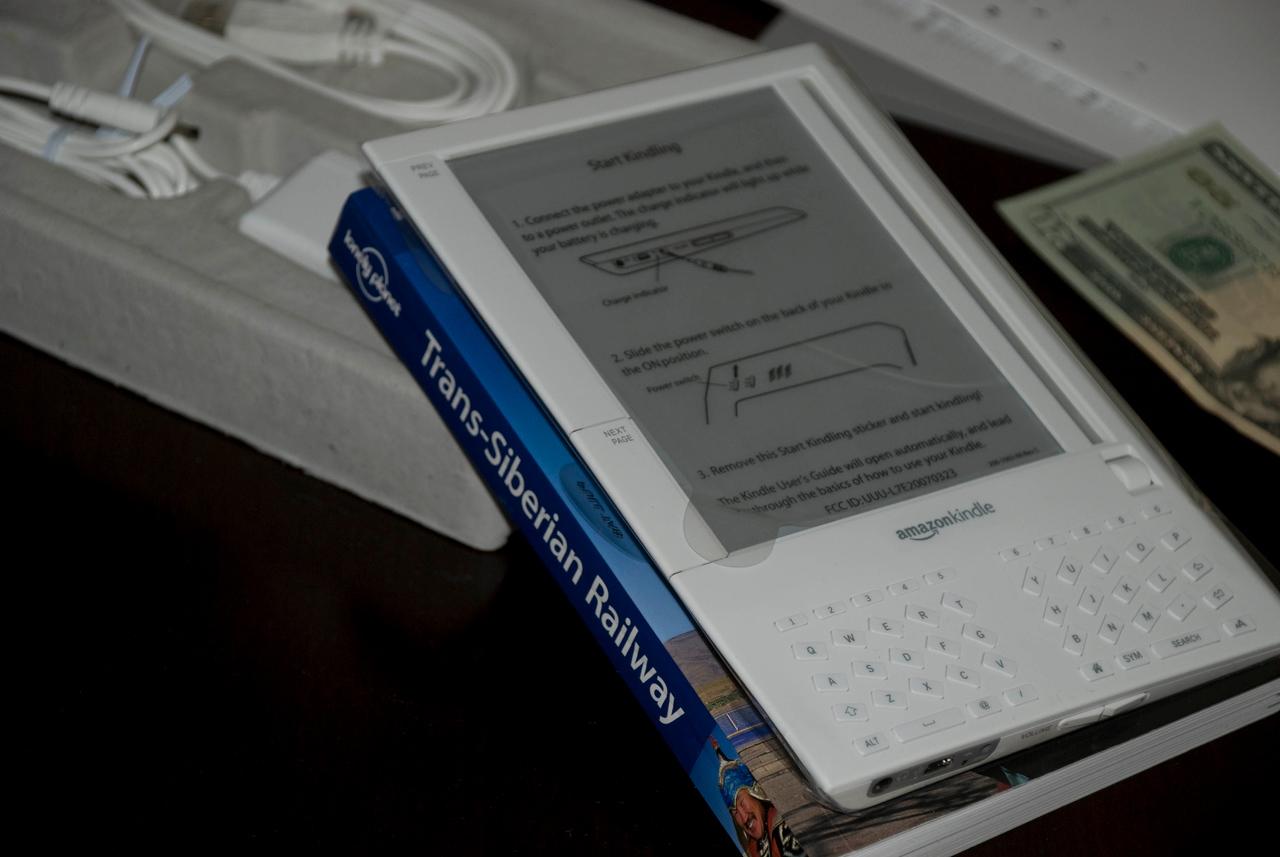 "A heck of a lot smaller than I had thought.  A buddy of mine turned me onto the Kindle on 11/20.  I went out and searched online and found some preliminary photos:<br /> <br />  <a href=""http://www.engadget.com/2006/09/11/amazon-kindle-meet-amazons-e-book-reader/"">http://www.engadget.com/2006/09/11/amazon-kindle-meet-amazons-e-book-reader/</a><br /> <br /> I wish I had done a bit more research at the time.  Those photos made me think it was HUGE - ala a TRS80 from Tandy kind of thing.<br /> <br /> Here are some comments I offered to my pal when he asked if I was going to purchase one:<br /> <br /> ""Not too impressed with it.  I don't want something the size of a big fucken' book as I'll have to carry around the laptop, the big fucken' book thing and all the power cables associated with it.  I want something that runs under Windows so I can have one device.  Period.""<br /> <br /> and<br /> <br /> ""I just don't think that one will be hot.  Too big, too bulky, etc.  I've never bought a reader before – other than a pocketpc.  Which, btw, I got a new one I'll have to show 'ya this weekend.  I'm gonna leave midmorning sometime tomorrow.  I'll call as I get closer.  Maybe we should do pizza and a movie sometime this weekend?""<br /> <br /> It's obviously quite different than what I had originally thought..."