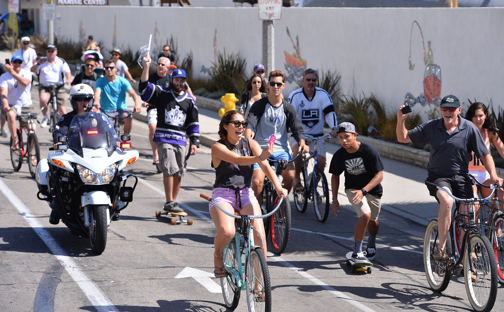 . Along Harbor Drive in Redondo Beach cyclists and skateboarders came along with the parade. Kings parade through the cities of Redondo Beach, Hermosa Beach, and Manhattan Beach. (June 18, 2014. Photo by Brad Graverson/The Daily Breeze)