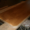 "Building countertops from scratch.  This is 3/4"" MDF board built up to 1-1/2"" thick with a pine front edge.  Here, the contact adhesive has been spread, waiting for it to dry."