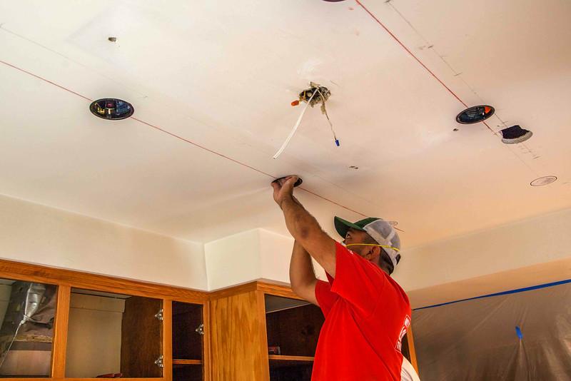 Ruben drills holes for new LED lights