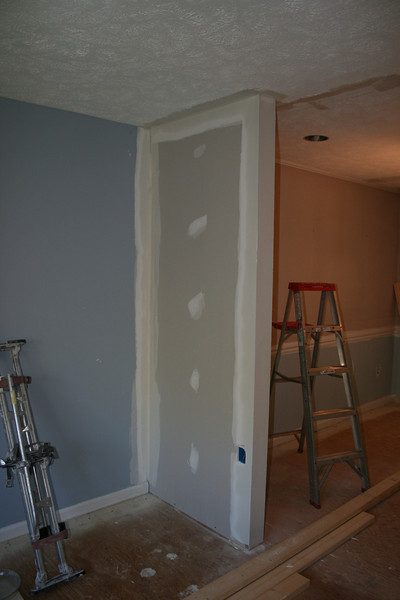 mud added to wall dividing dining room and living room