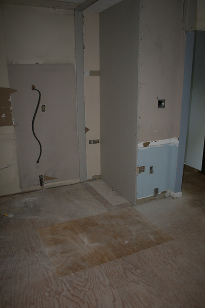 dry wall added to back of closet and I think where double ovens on the wall will go