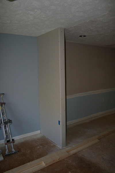 "new ""little"" wall between dining room and living room the dry wall added"