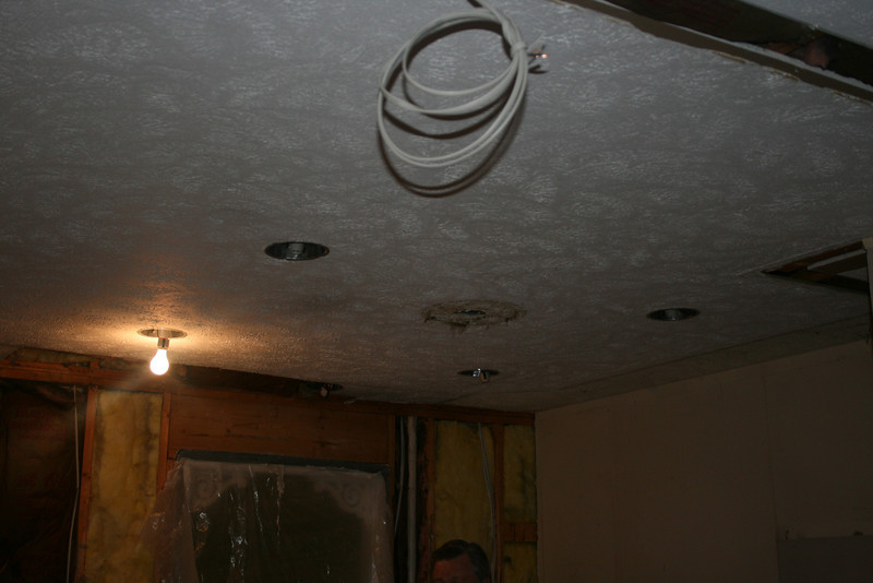 """Cans"" in the kitchen, big hole over the ""sink"" area out of the ceiling... that will be fun to fix...Big overhead ceiling light also GONE!!! (thank goodness)"