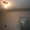 "the hole in kitchen ceiling yesterday is now covered with dry wall (is this gonna blend with old ceiling ""stuff""... time will tell :)"