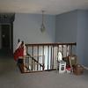 living room looking towards steps/front door