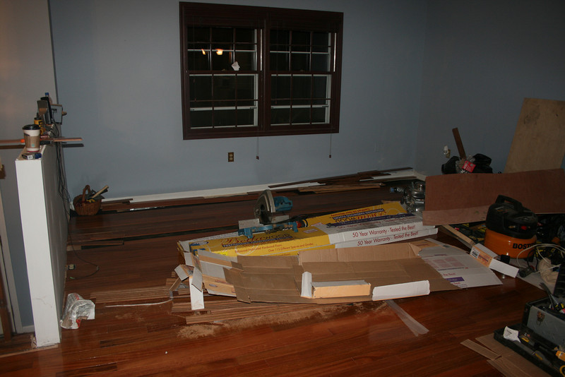 believe it or not living room is almost done with hardwood... yea!!!