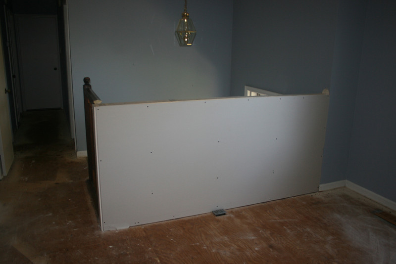 new wall at top of stairs (dry wall)