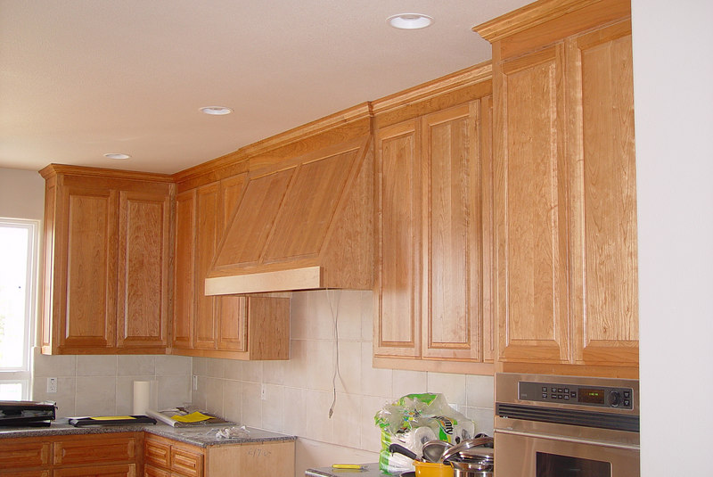Cherry Cabinets with Raised Panel Revere door and Crown Mold