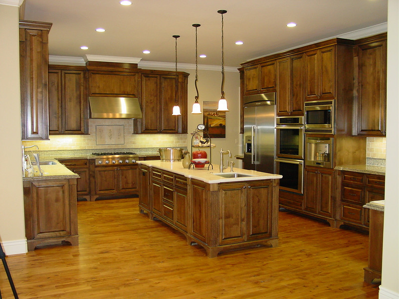 Full Overlay dark alder Kitchen with Furniture style feet and 10' ceiling