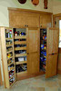 Pantry built into wall with pullout shelvs and pullout pantry system