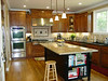 Alder cabinets with black laquer island