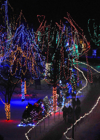 Pat Christman<br /> Pedestrians are seen from above as they walk through the Kiwanis Holiday Lights.