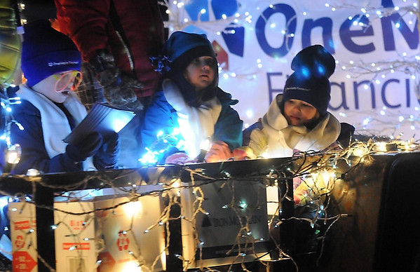 Pat Christman<br /> Children ride on a float during Friday's parade.