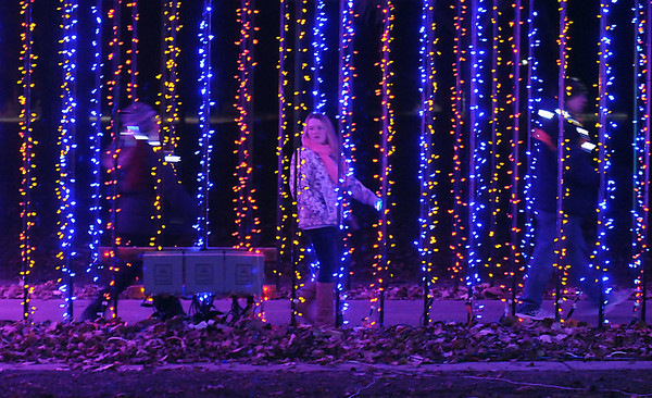Pat Christman<br /> A trio walk through one of the lighted tunnels at the Kiwanis Holiday Lights Friday.