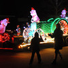 Pat Christman<br /> One of many lighted floats makes its way down Mound Avenue toward Sibley Park Friday night.