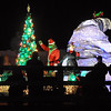 Pat Christman<br /> The Grinch waves to people in Sibley Park during Friday's parade.