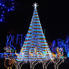 Pat Christman<br /> The large tree at the center of the Kiwanis Holiday Lights display was lit for the public for the first time this year Friday.