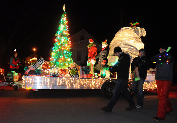 Pat Christman<br /> The Grinch rides on a float during Friday's parade.