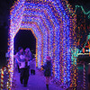 Pat Christman<br /> Visitors marvel at a new lighted tunnel added as part of this year's Kiwanis Holiday Lights Friday.