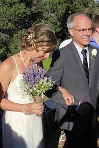 Kjirsten's hair and bouquet were beautiful.
