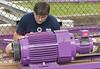John Fetterman looking at a motor for Kozmo's Kurves.