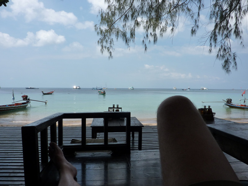 A view of the water and Colin's lower extremities from the restaurant at our bungalows on Ko Tao.  Life certainly does not suck!