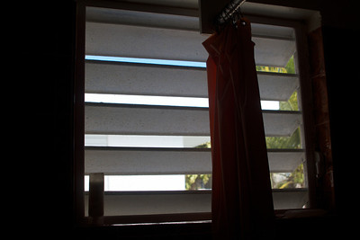 Here is the bathroom window. The shutters open part way to let a little bit of light in. This is the only light other than the inadequate electric lighting in the room.