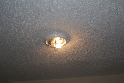 Here is a light fixture that is still in place but the glass enclosure or shade that goes on this is gone.